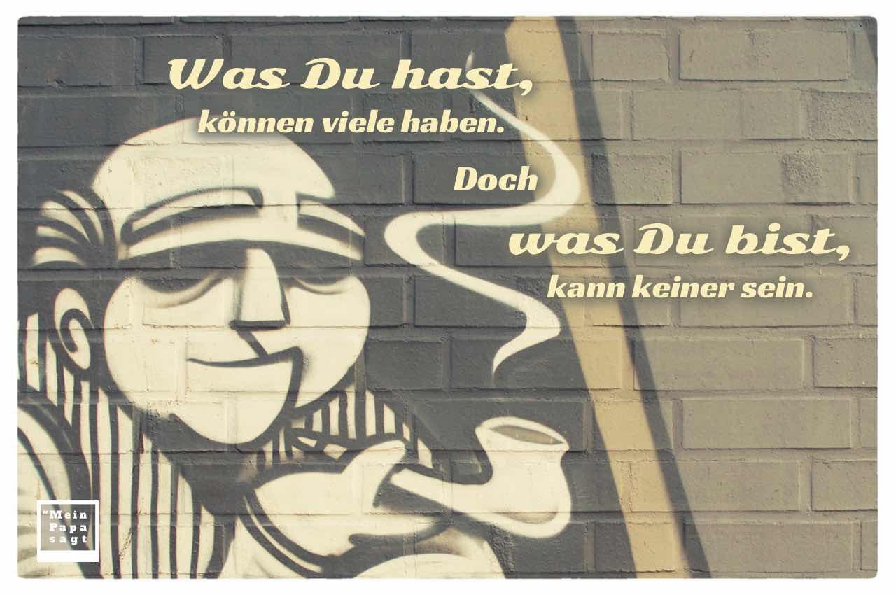 Graffiti mit altem Mann und dem Spruch: Was Du hast, können viele haben. Doch was Du bist, kann keiner sein.
