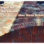 Mauerwerk am eWerk Berlin mit dem Ringel Zitat: Springen Sie, so oft Sie können, über Ihren Schatten! Erwin Ringel