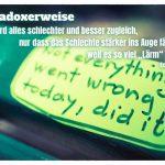 """Parkbank in Berlin mit Aufkleber und dem Tolle Zitat: Paradoxerweise wird alles schlechter und besser zugleich, nur dass das Schlechte stärker ins Auge fällt, weil es so viel """"Lärm"""" macht. Eckhart Tolle"""